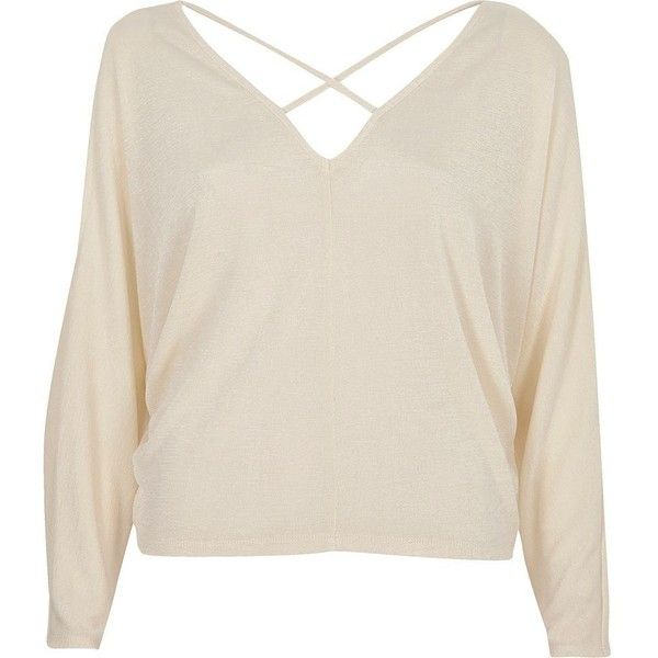 River Island Cream cold shoulder strappy batwing top ($52) ❤ liked on Polyvore featuring tops, bardot / cold shoulder tops, cream, women, strappy top, relaxed fit tops, bat sleeve tops, cream top and cut out shoulder top