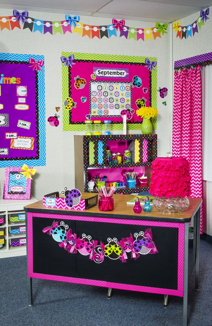 The Chevron themed classroom decorations from Teacher Created Resources are sure to brighten any classroom.  Features bright colors, chevron pattern, polka dots, stripes, ladybugs and so much more. Bulletin boards, border trim, accents, calendars and more items make up this room. Pink, blue, green, purple, yellow, orange.