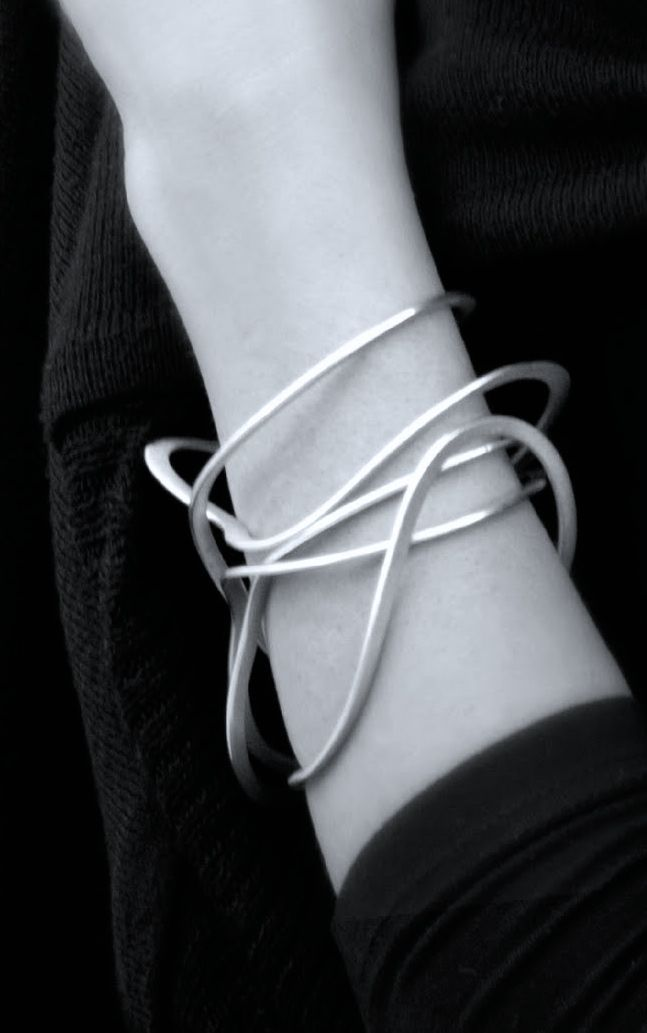 Liliana Guerreiro | Squiggle Bangle - elegant simplicity; chic statement jewelle...
