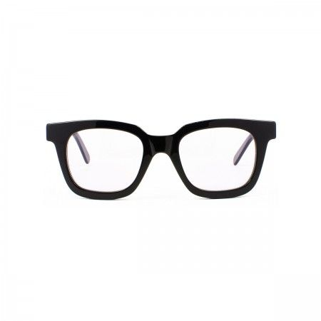 Lucy Ferres sunglasses with a classic black frame.