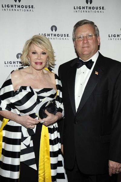 Joan Rivers accompanied by Lighthouse International President and CEO Mark Ackermann before she hosts the gala's silent auction.