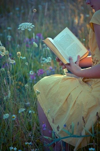 reading in a field of wildflowers.You know what ... i would drag a few pillows and an old quilt out to the field of wild flowers. A good book, hidden among the flowers, peace and quiet ... PERFECT.