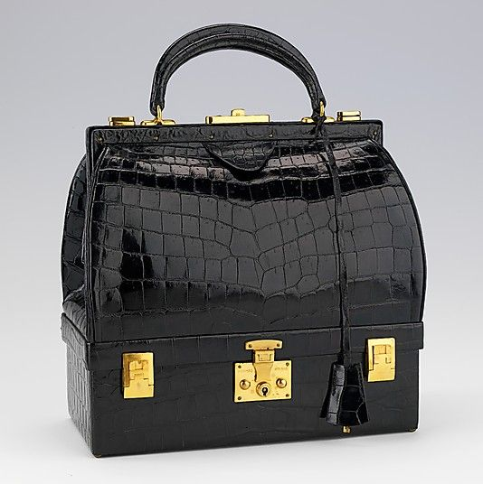 """""""Mallette""""  Hermès (French, founded 1837)  Date: ca. 1950 Culture: French Medium: leather, metal, syntheticL'énigme"""