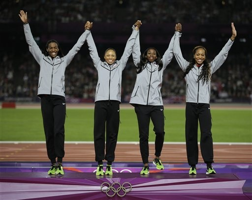 USA's DeeDee Trotter, Allyson Felix, Francena McCorory and Sanya Richards-Ross react before receiving their gold medals for the women's 4x400-meter during the athletics in the Olympic Stadium at the 2012 Summer Olympics, London, Saturday, Aug. 11, 2012. (AP Photo/Matt Slocum)