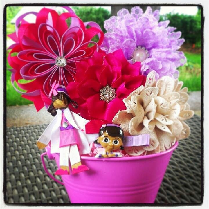 $35 DOC McStuffins inspired Themed Bow-quets. All hair clips can be worn alone or on the included headband that comes with each bow-quet. Visit www.facebook.com/bowquets . Customized for you:) All proceeds goes towards medical expenses for my twin boys:) Please read our story on why i started Bow-Quets. Never give a boring gift again:D