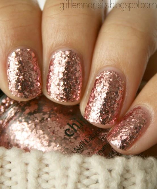 Glitter rose pink nails.