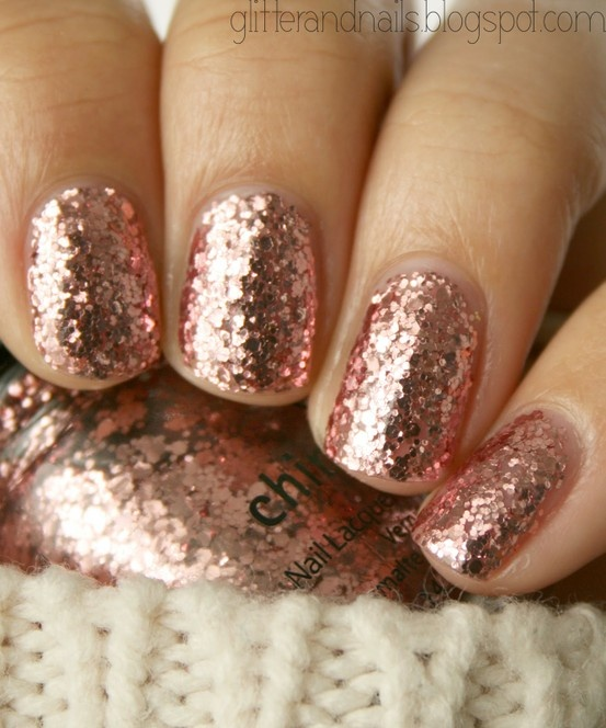 Glitter rose pink nails.