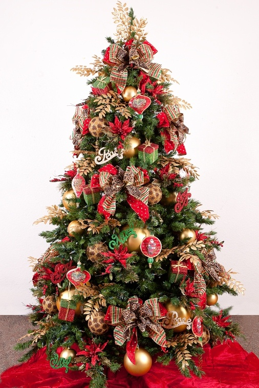 Christmas Tree-Gone Wild with a touch of leopard ribbon mixed with plaids and stripes to take your personal mixture of family ornaments over the top.