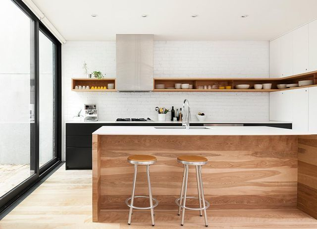 Kitchen // white painted brick wall, Matte black lower cabinets with white countertops, Wood, etc.