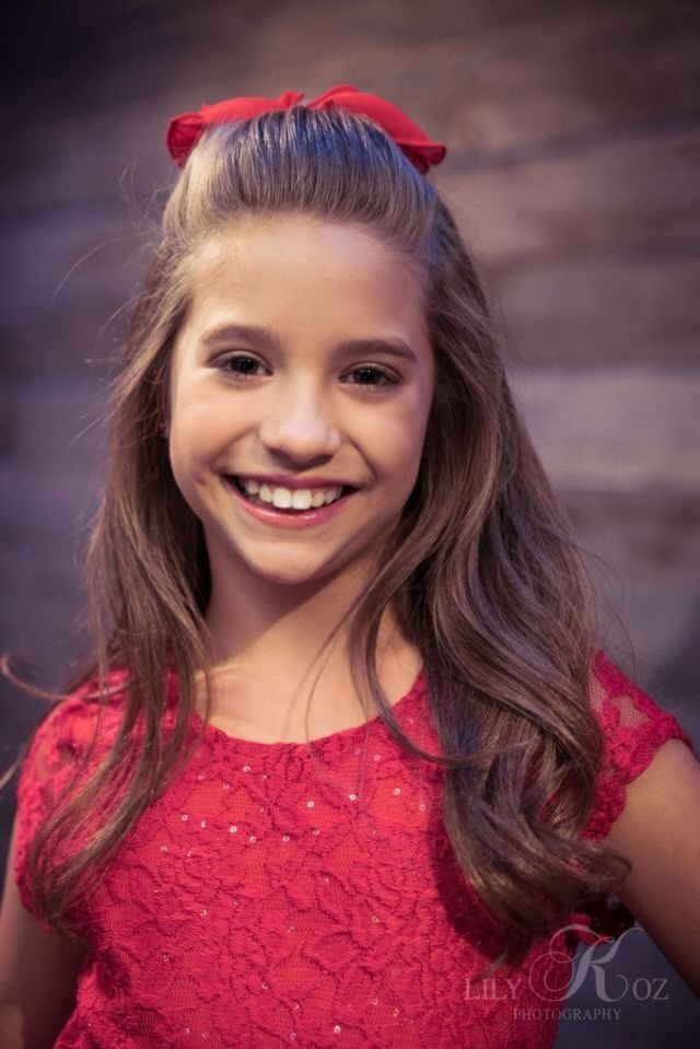 Hi I'm Mackenzie you could call me Kenzie I'm 10 years old and I have a 12 year old sister Maddie. I'm also known as Mack Z. My most famous songs are girl party and shine.