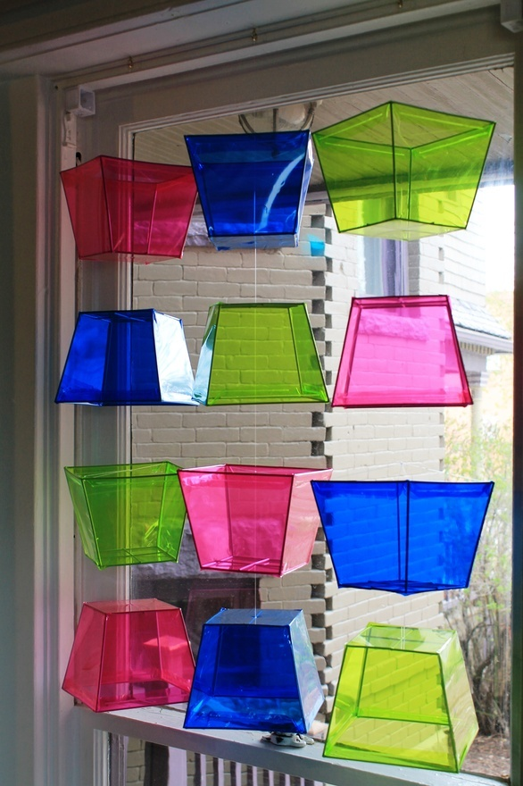 Dollar store storage containers turned quirky window display. babyorchid
