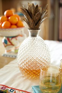 This will freshen up anyone's bar cart. It's Pier 1's brilliant, handcrafted Pineapple Decanter, rendered in the classic pineapple shape and topped dramatically with metal leaves. It's truly a work of art, as no two are exactly alike. A real showstopper w