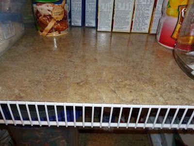 Vinyl floor tiles on wire shelves.