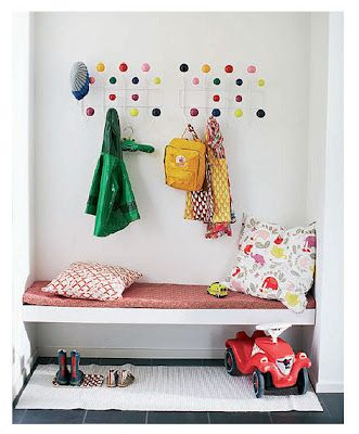 gorgeous entry / mudroom area for kids w/ eames hooks