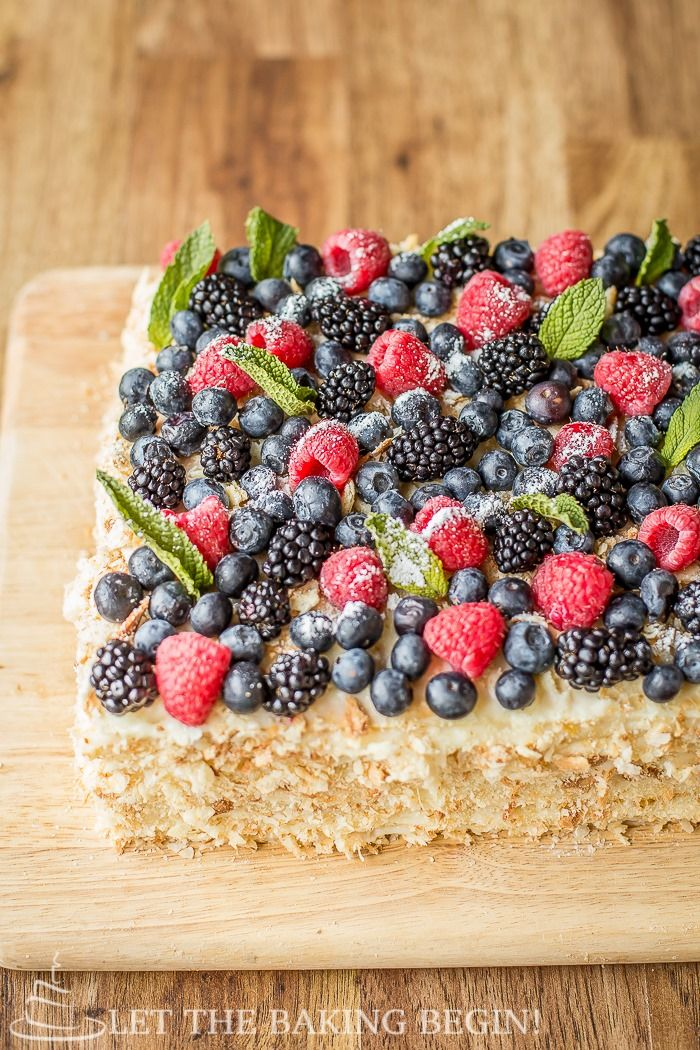 Delicious puff pastry cake, layered with custard  topped with berries. Plus a tip on how to speed up the baking process.