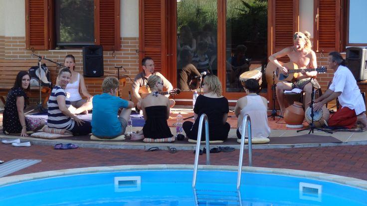 Kirtan band at the pool in a yoga retreat.