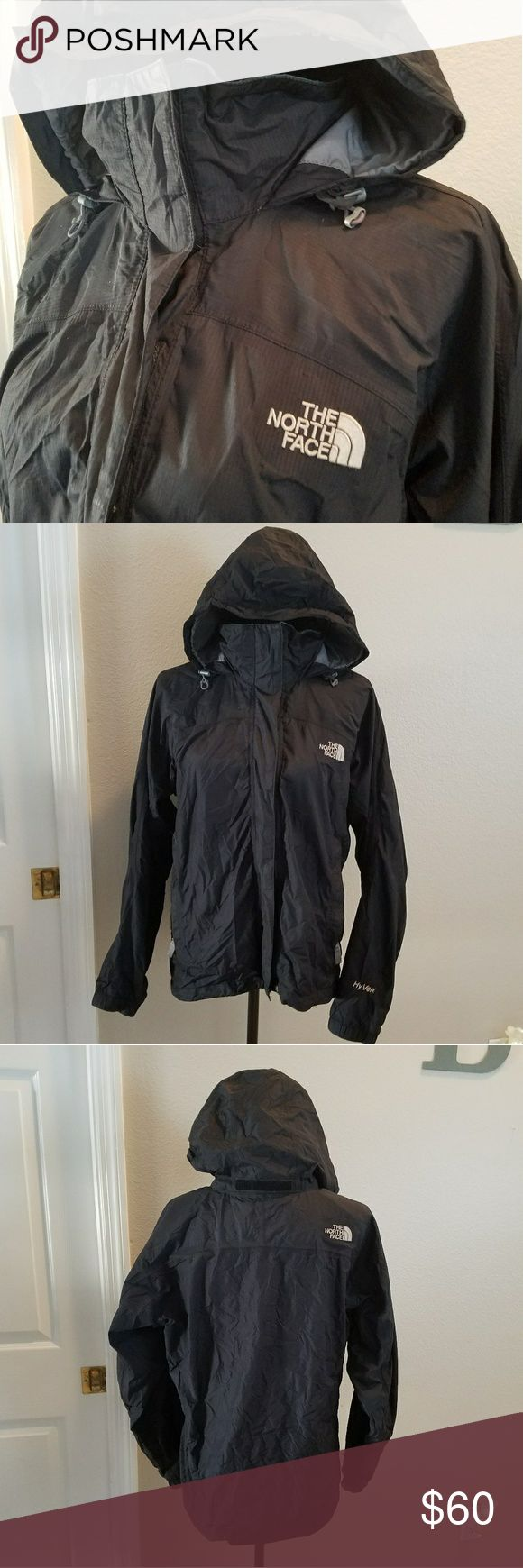 NORTH FACE BLACK RAIN COAT SIZE MED Black RAINCOAT. Size medium. In great condition, some lint present in inside Velcro shown in pic. The hood can be folded under collar as shown above. Tightening strings on the hood.  Has a zipper and Velcro. Has 2 pockets. The North Face Jackets & Coats