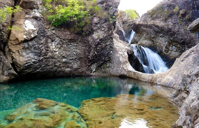 Whether or not anything magical happens when you enter the clear blue lakes and waterfalls of the Fairy Pools on the Isle of Skye is unknown, but a visit to the blue- and pink-hued waters conjures up mental images of a fairy tale land.