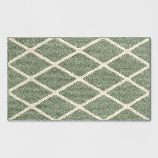 Cover up cold tiles in your kitchen or bathroom with this Diamond Rug from Threshold™. This diamond-pattern rug will brighten up your home and look lovely in a variety of spaces. It's great for the entryway to protect your flooring from heavy foot traffic and to keep your family from tracking in any unwanted mess. This machine washable rug is made with a stain-resistant material and backed with durable polypropylene to keep up with your busy household.