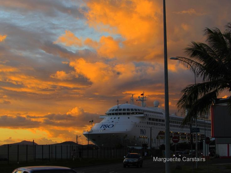 The most magnificent colors of a sunset at Noumea with the sun setting behind the cruise ship Pacific Dawn..