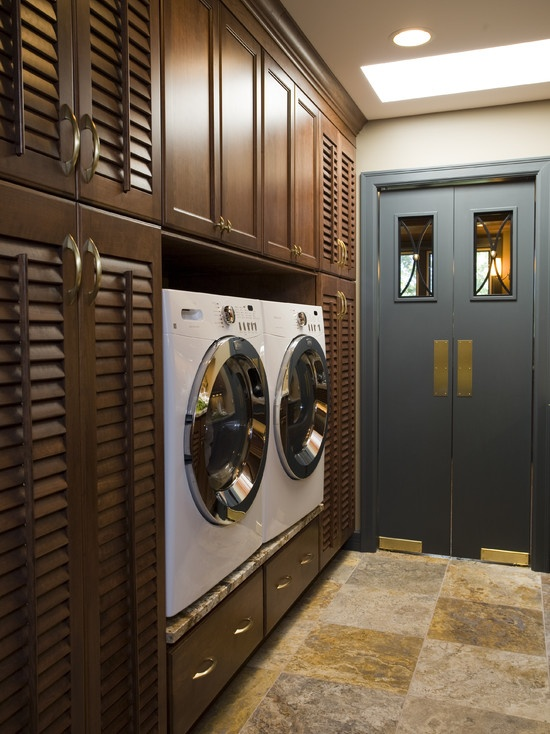 This is *THE MOST* amazing laundry room I have ever seen! Sleek, butler doors, stone, wood, bright...drool!!
