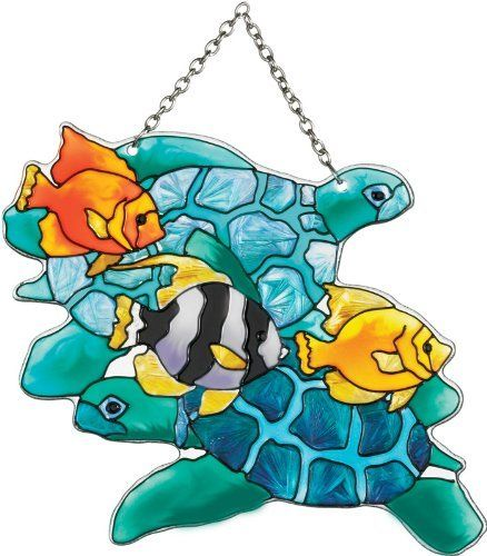 Joan Baker Designs SSD1025 Turtles and Fish Art Glass Suncatcher by Joan Baker Designs. $21.00. Hand-painted. Vivid translucent color for window display. Water-cut fired glass. Chain included for convenient hanging in a window. This hand-painted water-cut Suncatcher brings the rich sea life of a tropical reef to your window    For more than 40 years, Joan Baker Designs' talented artisans have created stunning decorative art glass items. Each piece is designed in our San Clemente,...