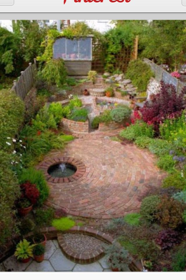 Circular paved courtyard outdoor structures and spaces for Paved courtyard garden ideas