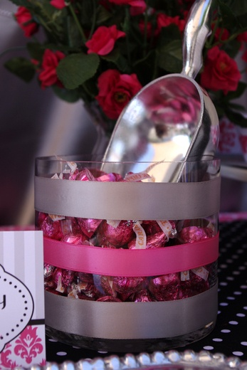 decorate with ribbon around glass vase/container