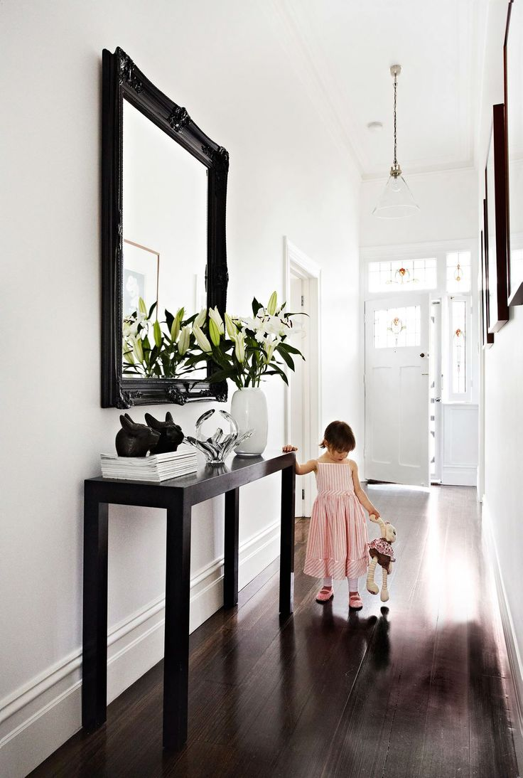 "Punctuating the hallway in this Melbourne home is a hall table from [Mossgreen Auctions](http://www.mossgreen.com.au/content/|target=""_blank""). A mirror sourced from [eBay](http://www.ebay.com.au/