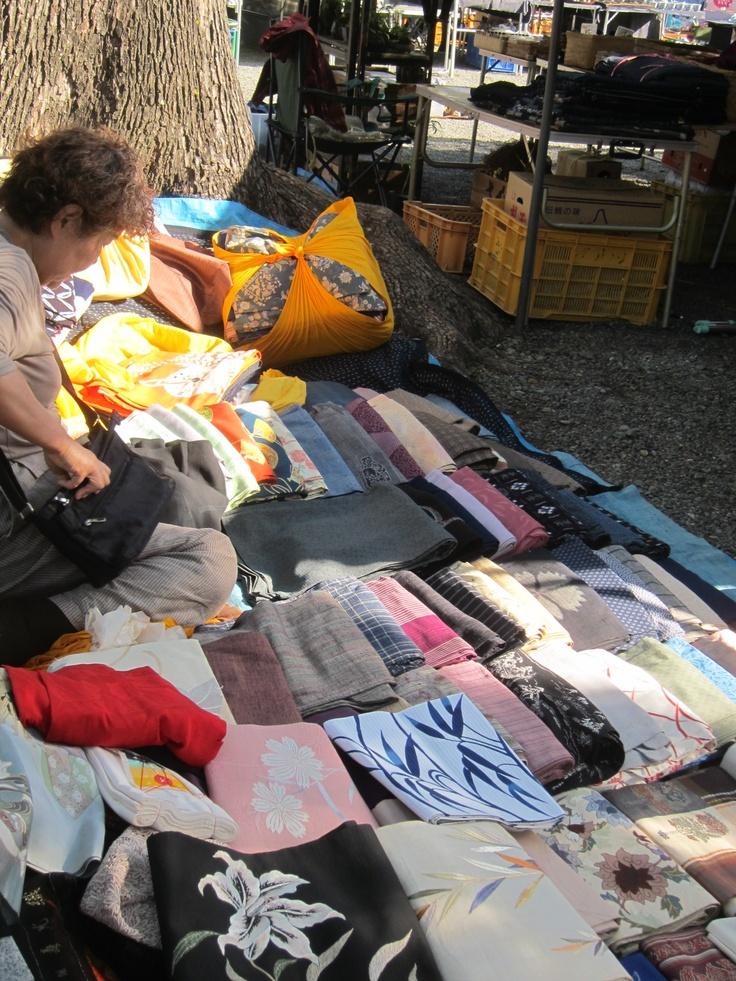 Woman setting up her Kimono and Obi for sale at the Machida shrine sale