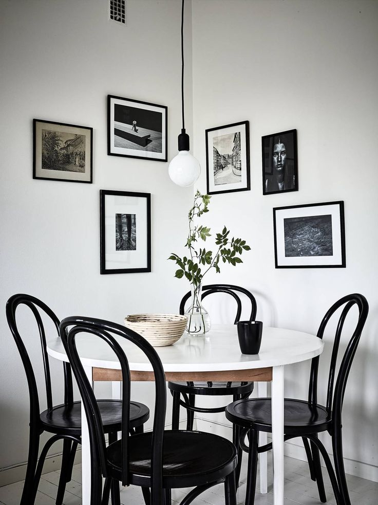 Black bentwood chairs with white modern table