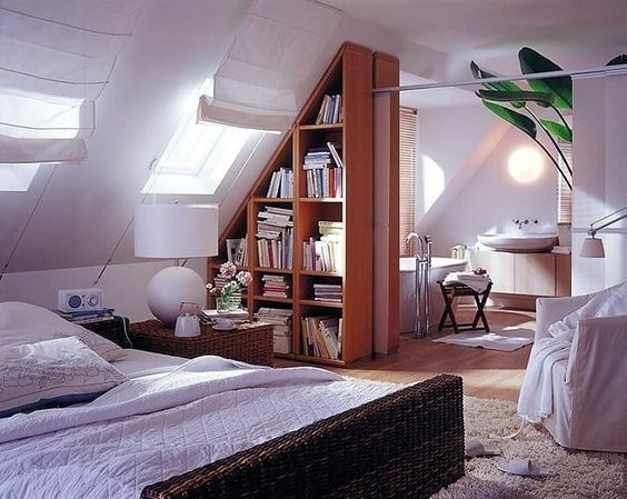 Loft Conversion With Sloped Bookshelf Sliding Room Divider | Love this semi-open bed & bath set up.