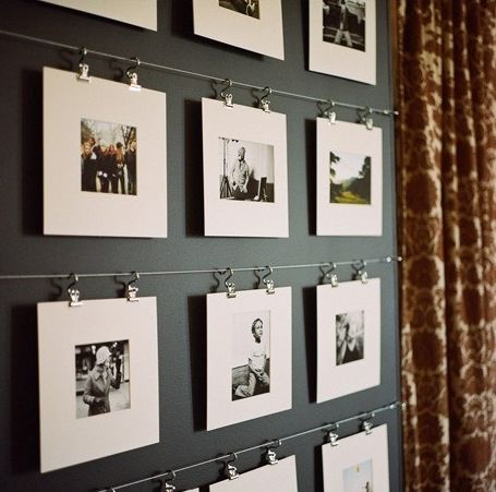 """An interesting way of displaying photography, without the use of frames. This could be a more cost effective means of shorter term display.  Instead of stacking rows of clothes lines, we could have one or two rows, either alternating the """"then"""" and """"now"""" photos or stacking them.  This method of hanging would circumvent putting holes in the wall for each picture."""