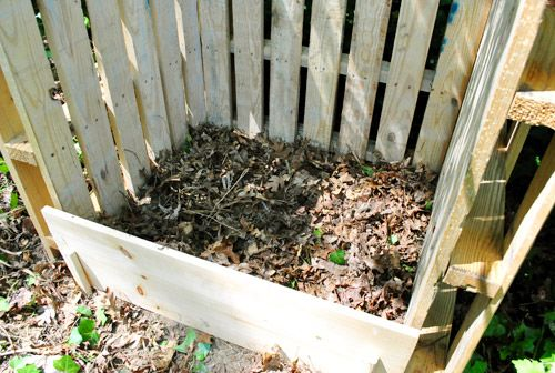 A Pallet-able Compost Post... where the first shelf is I will put a metal shelf so the compost would fall to the ground then shovel out below decomposed material that fell thru | Young House Love