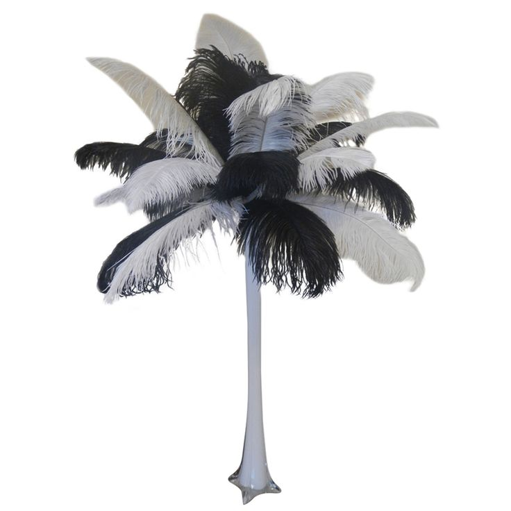 Our Black & White Ostrich Feather Centerpiece features an eiffel tower vase and elegant feathers. Shop more ostrich feather centerpieces today at EventsWholesale.com.