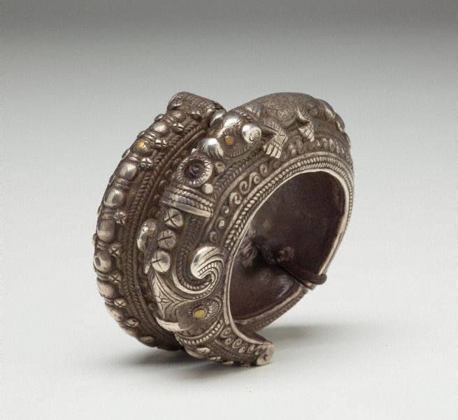 ndonesia ~ Sumatra. Golang Tangan (bracelet) from the Batak (Toba) people. Silver. This bracelet is decorated with masculine emblems of power, the 'naga' and the 'singa'.