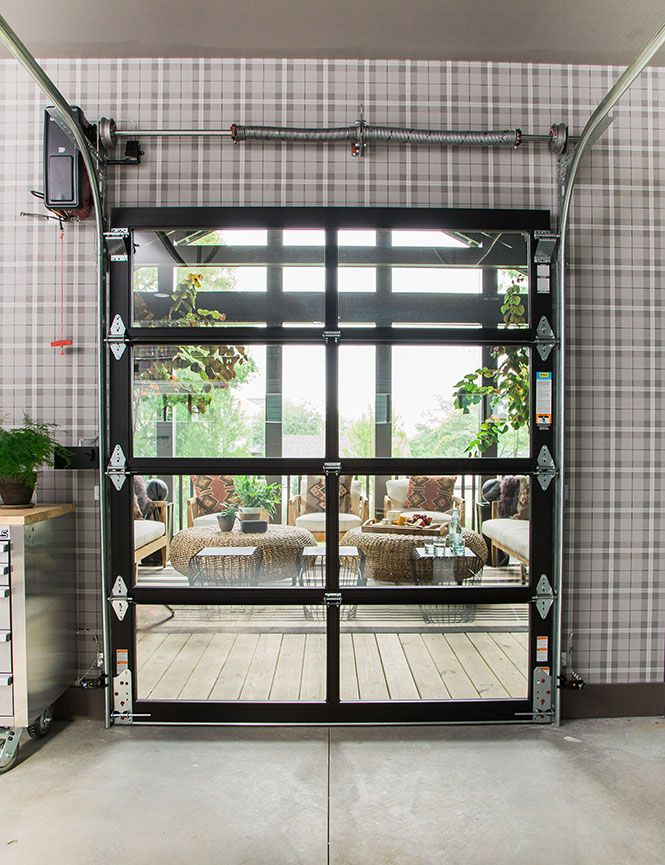 Inside the HGTV Urban Oasis 2016 garage, unexpected, yet stylish, contemporary design elements like a Clopay Avante Collection glass garage door connect the garage to the screened porch, making the space a perfect entertaining oasis. www.clopaydoor.com