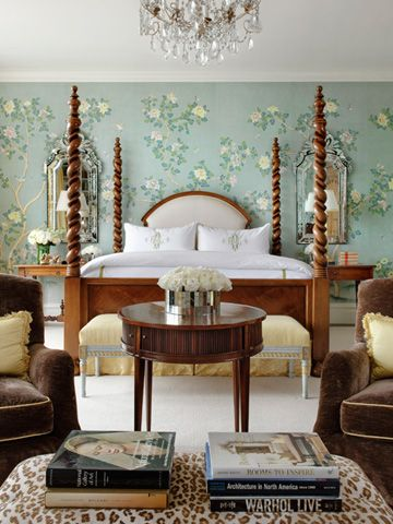 A very balanced bedroom. Like the two venetian mirrors hung above the side tables.