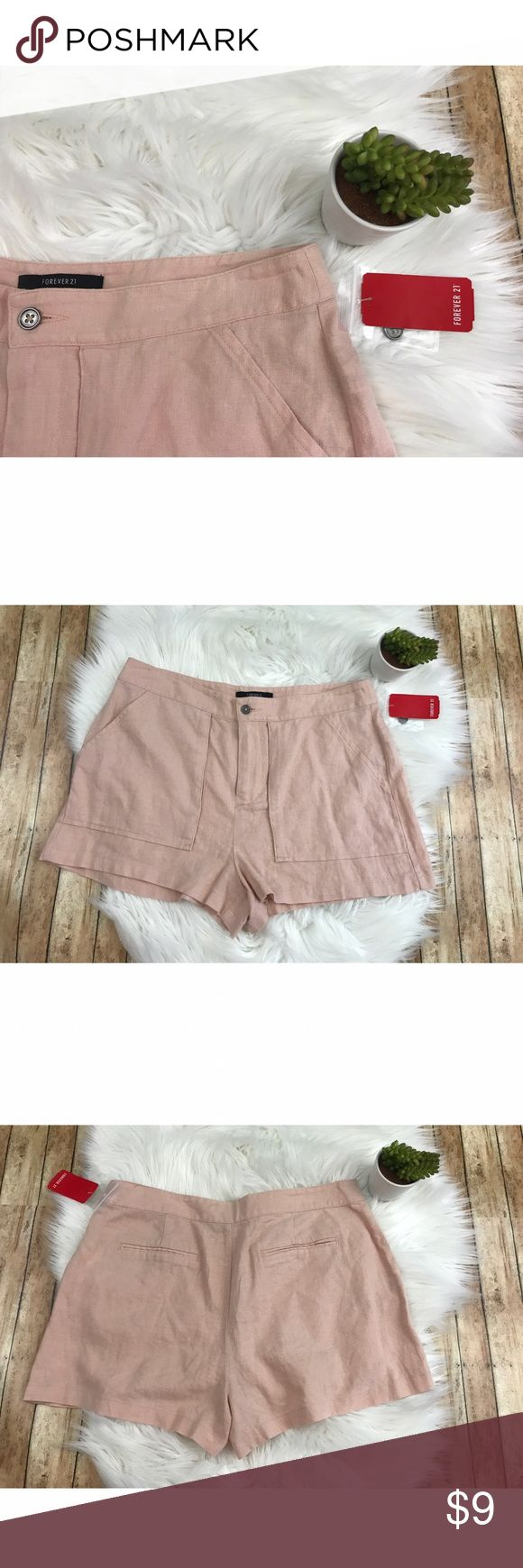 """NWT Forever 21 Light Pink Shorts NWT Forever 21 Light Pink Shorts. Made of 55% Linen and 45% Rayon. Has a couple of brown-ish marks on the waistband and a small snag on the back under the waistband. comes from a smoke free, pet friendly home. 🚫NO TRADES! Measurements: -Inseam: 2"""" -Waist: 14.5"""" -Top To Bottom: 12.5"""" Forever 21 Shorts"""