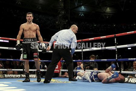 Challenger George Groves is kncoked down by Carl Froch in their IBF and WBA World Super Middleweight bout at Wembley Stadium on May 31, 2014 in London, England.  (Photo by Scott Heavey/Getty Images)
