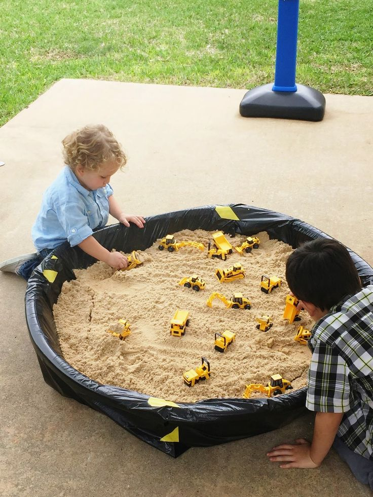 Sand dig kid's activity for a construction-themed birthday party. Play sand and mini plastic construction vehicle toys. See more photos, décor and DIY project details from this party at www.fabeveryday.com.