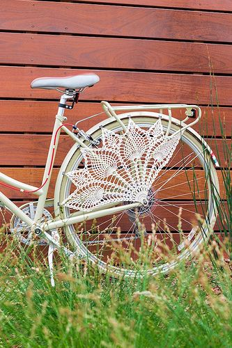 Spring is on it's way! What a beautiful way to jazz up your bicycle.  Crochet Bicycle Skirt Guard by Knits for Life by LornaWatt, via Flickr