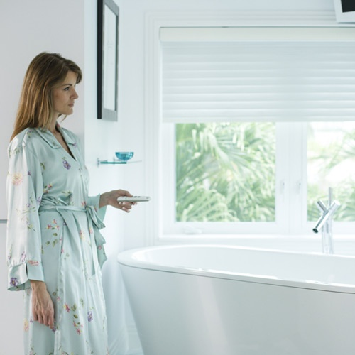 Privacy can instantly be achieved with motorization and is especially convenient when preparing for a bath.