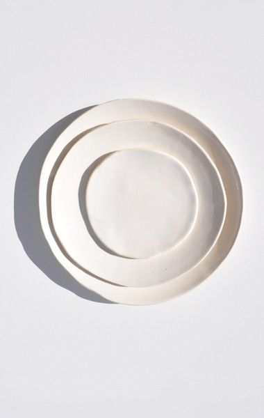 "AKIKO GRAHAM WHITE PORCELAIN PLATES Available in 6"", 9"", and 10.5"" Handmade in Seattle"