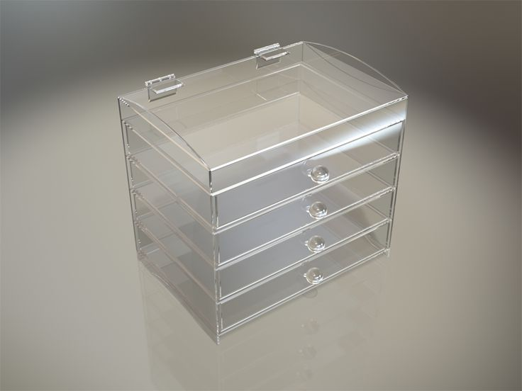 This counter top standing storage organizer is manufactured in high quality clear Plexiglas acrylic. This style organizer has a hinging top storage area. The unit includes four pull out storage drawers with two lose fitting slide inserts for each draw allowing your own personal storage layout to be created