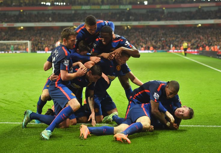 @manutd players embark on a passionate celebration at the Emirates Stadium wearing the current third kit. You can get yours from United Direct.