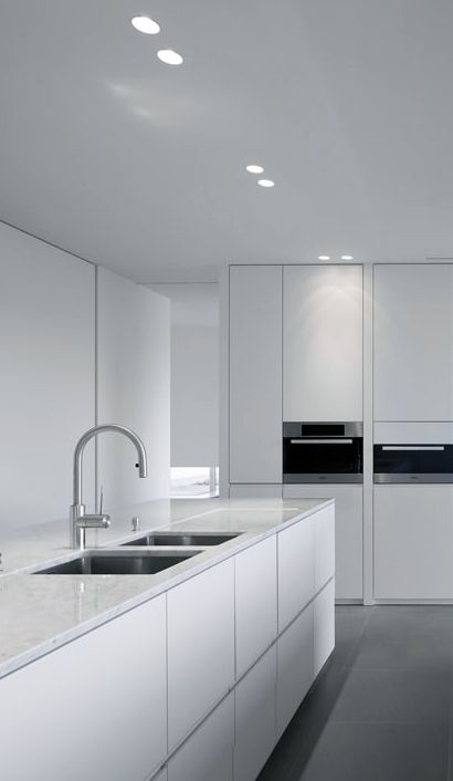 Modern Kitchen White love the grey caesarstone bench top adds warmth and depth and