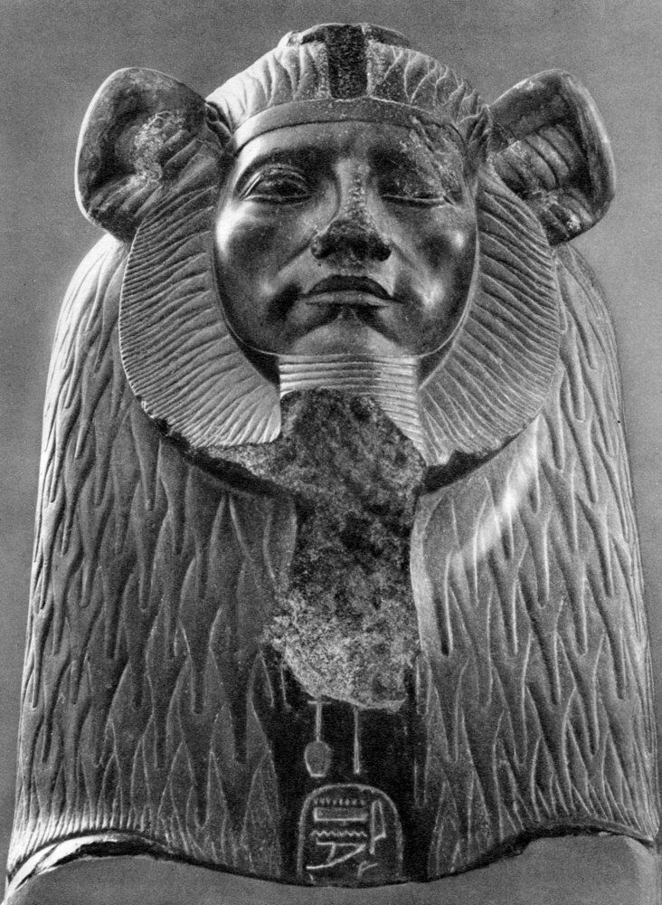 A granite sphinx of King Amenemhat III, with the rarer lion's mane, replacing the usual  striped Nemes cloth headdress. 12th dynasty, c1820 BC. Black granite. From a Tanite Temple. Cairo Egyptian Museum. Photography from 'The Art of Ancient Egypt', Phaidon Press (Vienna, 1936).