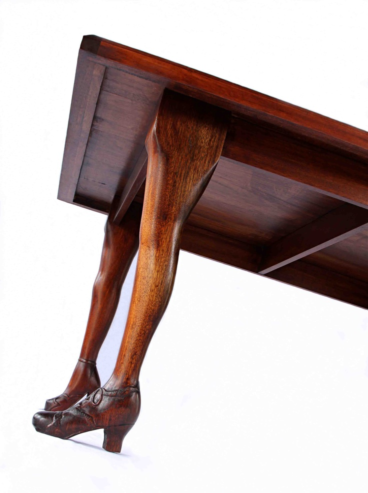 Uncle Graham Table.  Hand carved legs, French Polished mahogany top. Female legs smoother than the male legs. Dimensions are a proportion of 1.618.