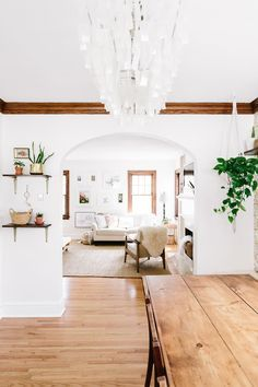 An airy Minnesota home decorated with homemade furniture, lush plants  and children's artwork.
